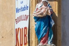 Nearly every street corner in Aix en Provence has a religious statue, often beautifully carved and painted. Sometimes they form a strange partnership with adverts for all sorts of goods.